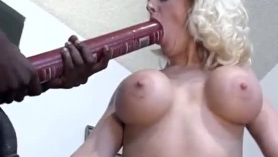 Busty, black milf with red hair is fucking her black lover, in her living room