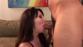 Naughty brunette is using a pink sex toy, while teasing, in front of the camera