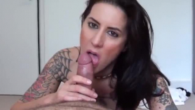 Excited chick is kneeling and sucking a big, black dick, while her partner is moaning from pleasure