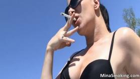 Smoking hot milf in white gi and black stockings